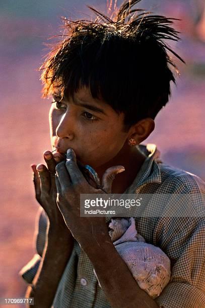 Boy playing Jew's harp Jaisalmer Rajasthan India