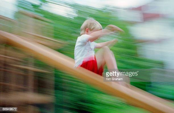 Boy Playing on a Slide England
