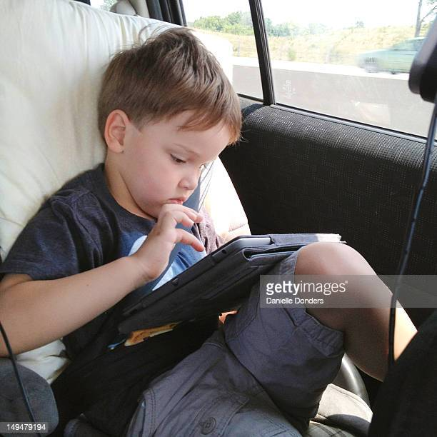 Boy playing on digital tablet