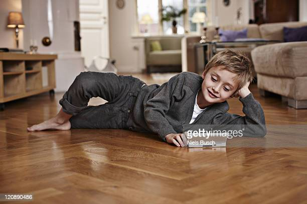 Boy playing on floor in living room