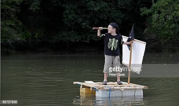 boy playing on raft in the water
