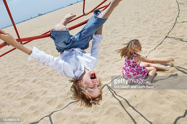 Boy playing on ropes on beach