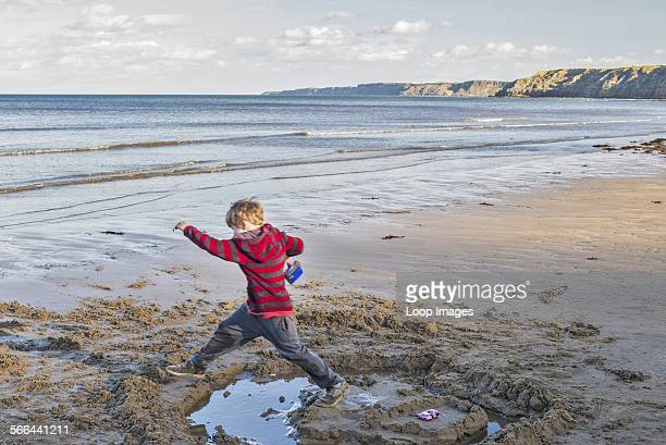 A boy playing on South Beach in Scarborough