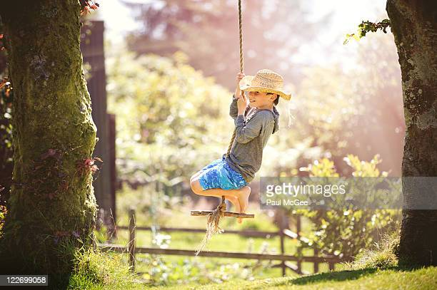 Boy playing on swing
