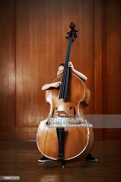 Boy playing oversized cello
