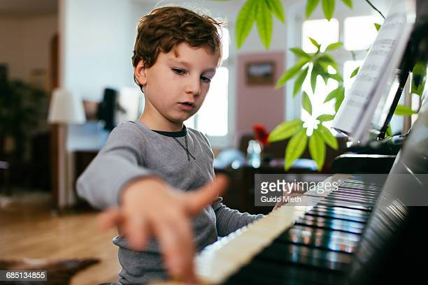 Boy playing piano.