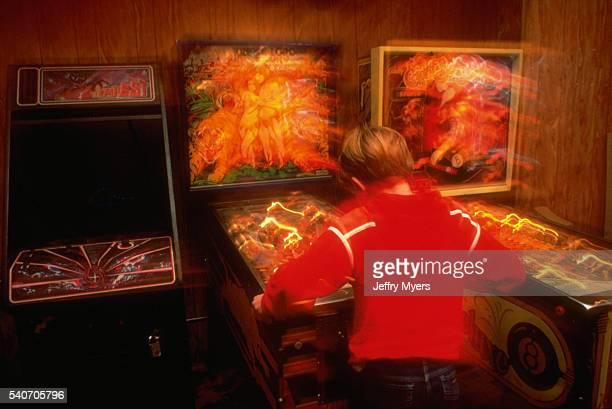 Boy Playing Pinball