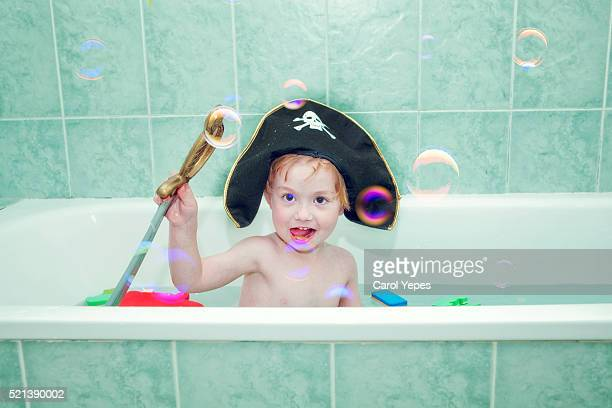 boy playing pirate games  in bathtube