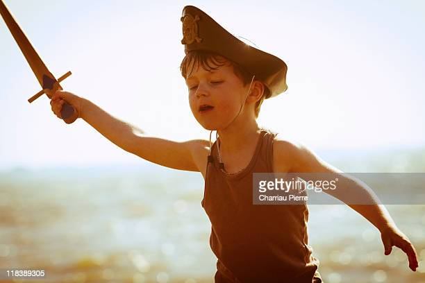 Boy playing pirate, wooden sword