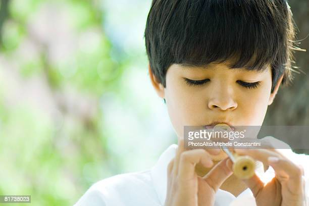 boy playing recorder - recorder musical instrument stock photos and pictures