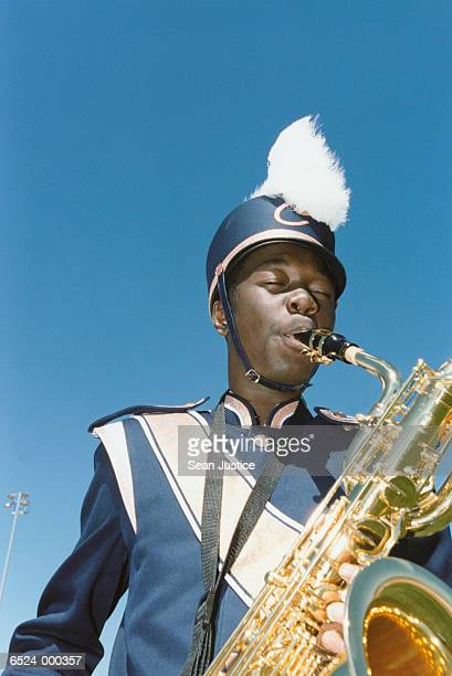 boy playing saxophone - marching band stock pictures, royalty-free photos & images