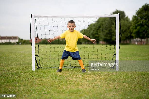 boy playing soccer as a goalkeeper - goalkeeper stock pictures, royalty-free photos & images