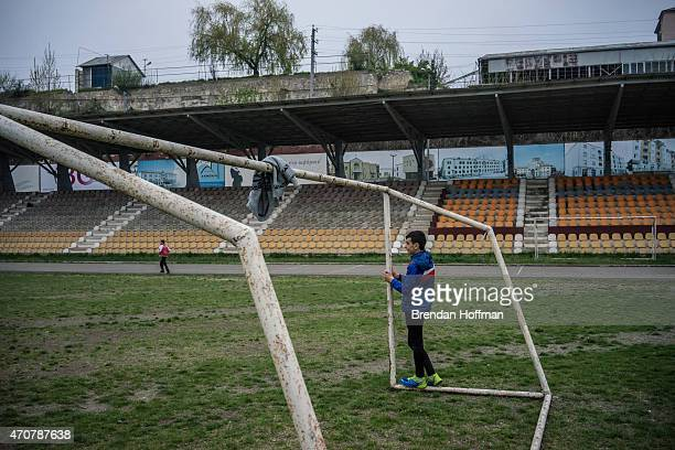Boy playing soccer with friends waits by the goal he is defending on April 20, 2015 in Stepanakert, Nagorno-Karabakh. Since signing a ceasefire in a...