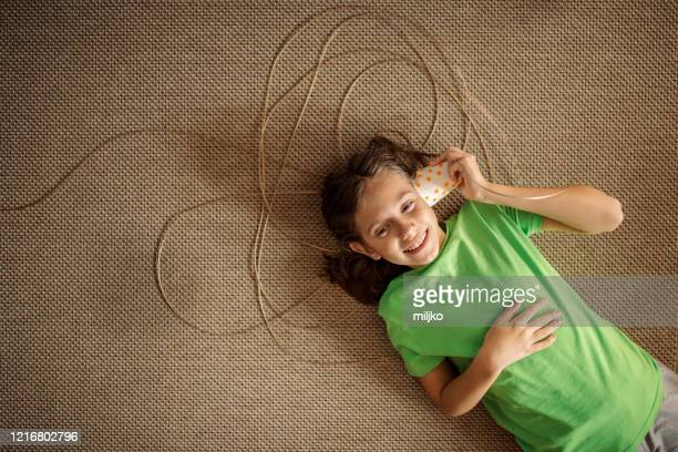 boy playing social distance communication - miljko stock pictures, royalty-free photos & images