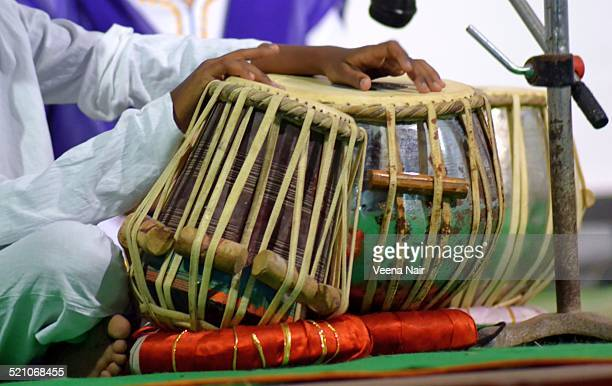 A boy playing tabla