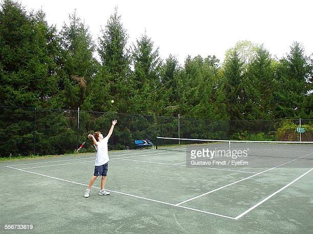 Boy Playing Tennis Against Clear Sky
