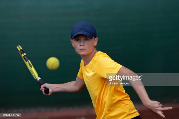boy playing tennis - tennis stock pictures, royalty-free photos & images
