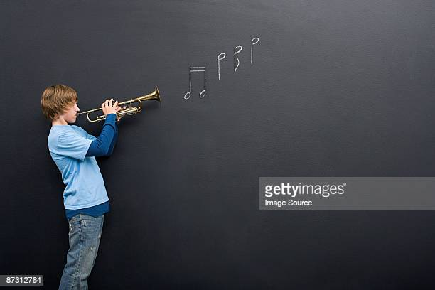 A boy playing the trumpet