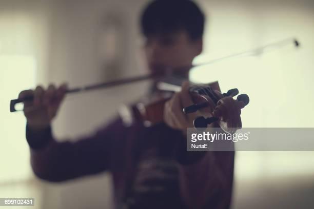 Boy playing the violin