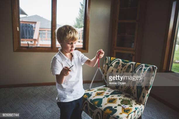 Boy Playing Triangle