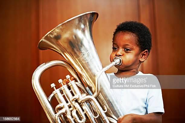 Boy playing tuba