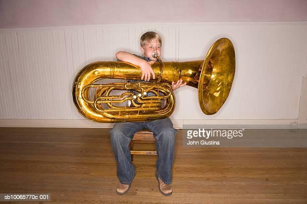 Boy (8-9) playing tuba