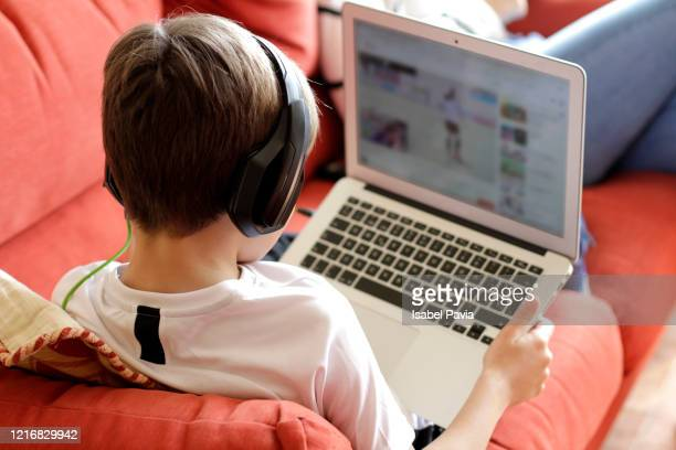 boy playing video game on computer - childhood stock pictures, royalty-free photos & images