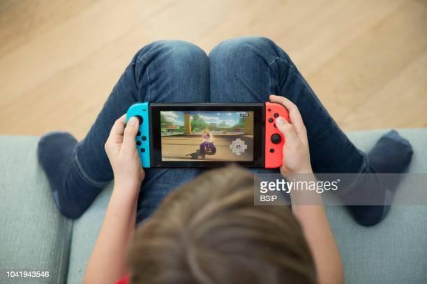 Boy playing video game.
