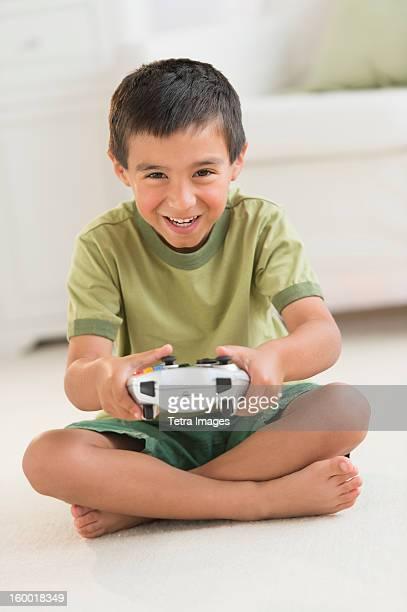 Boy (6-7) playing video game
