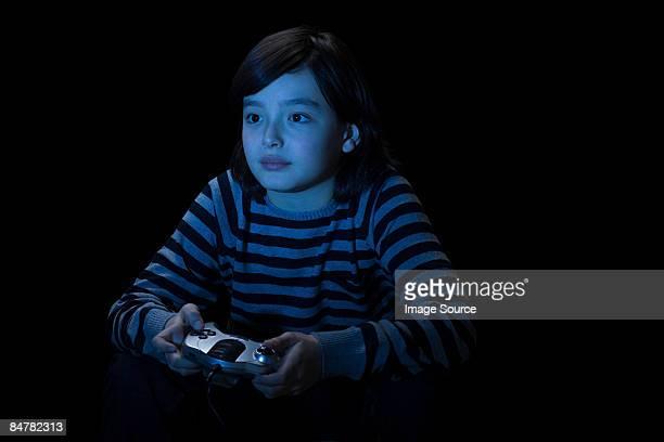 boy playing video game - blue film video stock-fotos und bilder