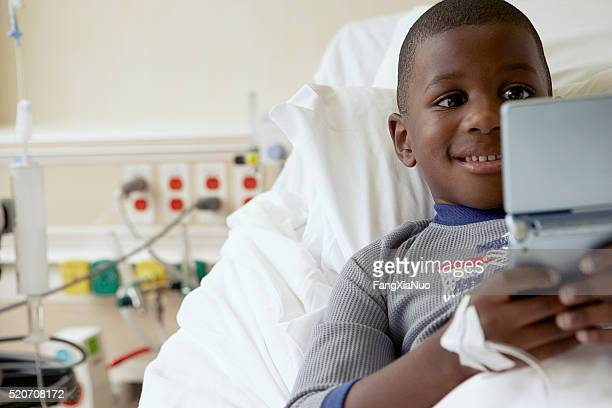 Boy playing video games in a hospital