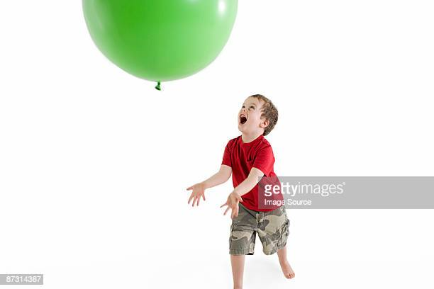 A boy playing with a balloon