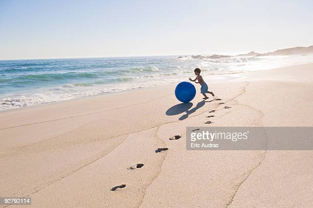Boy playing with a beach ball