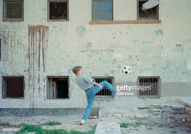 A boy playing with a football in Zadar Croatia during the Croatian War of Independence November 1994