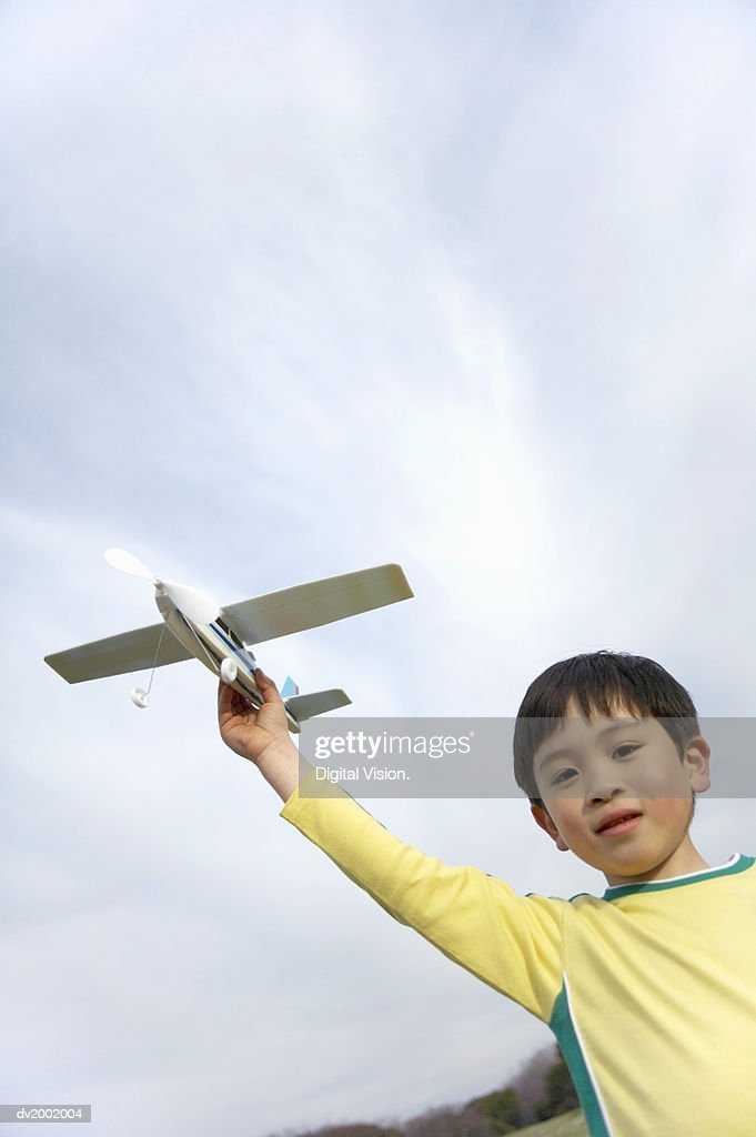 Boy Playing with a Toy Plane : Stock Photo