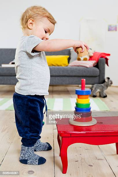 Boy playing with blocks at home