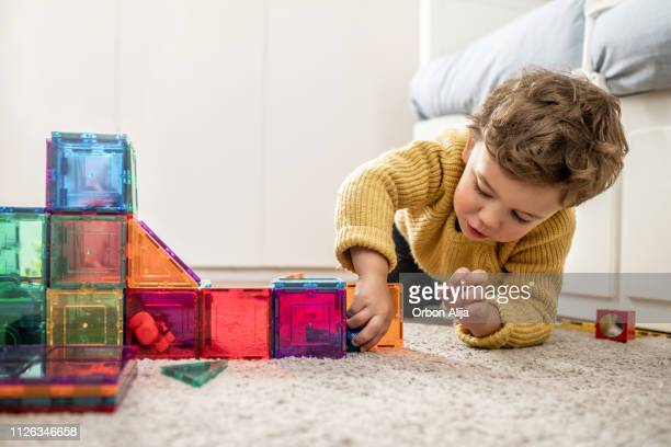 boy playing with building blocks - leisure games stock pictures, royalty-free photos & images