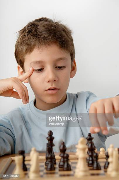 Boy playing with chess