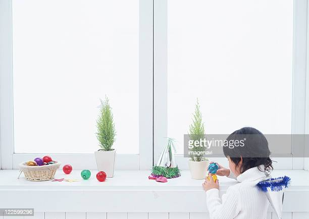 Boy playing with christmas ornaments