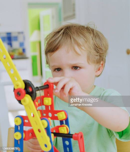 boy playing with connector toy - preschool stock pictures, royalty-free photos & images