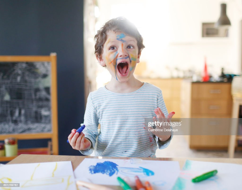 A boy playing with felt pens : Stock Photo