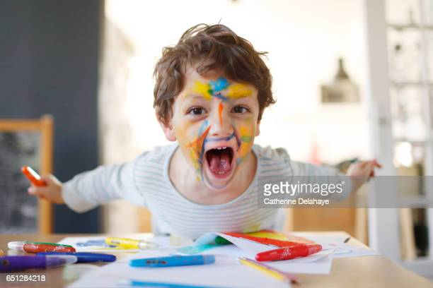 A boy playing with felt pens