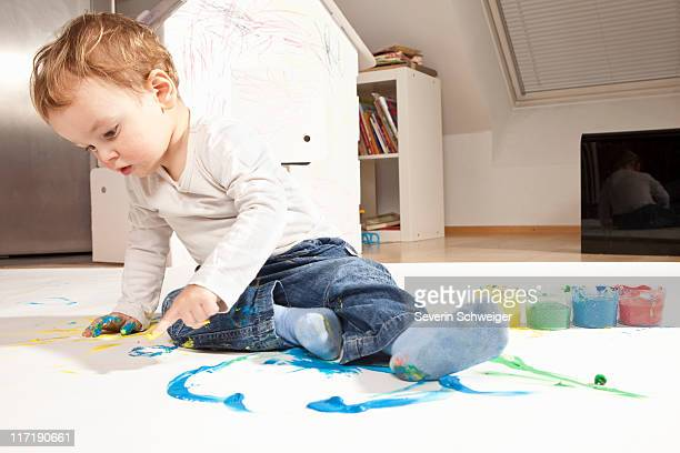 Boy playing with finger paint