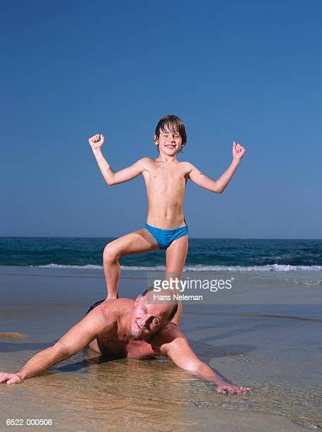 boy playing with grandfather - zwembroek stockfoto's en -beelden