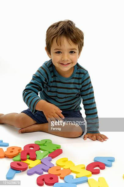 Boy playing with numbers and letters