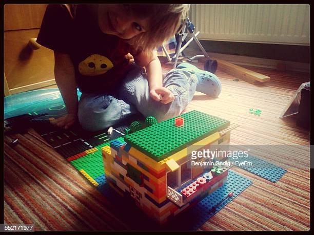 Boy Playing With Plastic Blocks