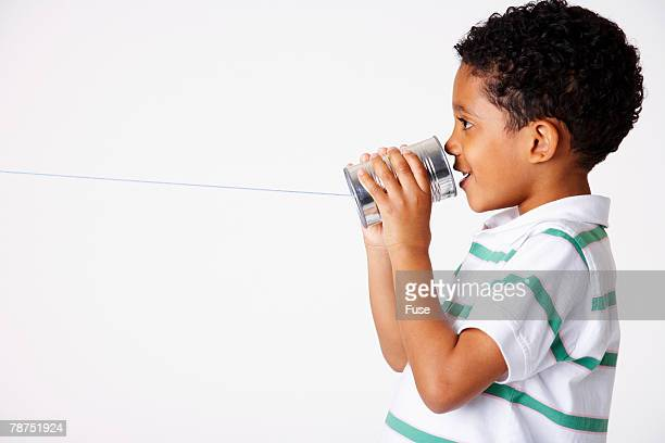 Boy Playing with Tin Can Phone