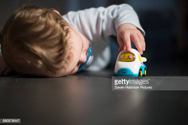 Boy Playing with Toy Car