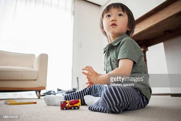 Boy playing with toy car,  portrait