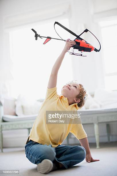 boy playing with toy helicopter - toy stock pictures, royalty-free photos & images
